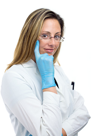 young medical doctor woman thinking Isolated in white background photo