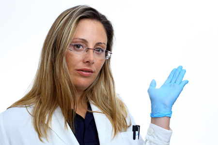doctor woman pointing his hand at white space, showing something in the background photo