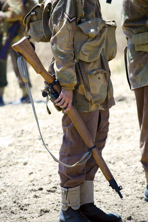 german soldier: wwii  English soldier with rifle of the second world war in a historical reenactment