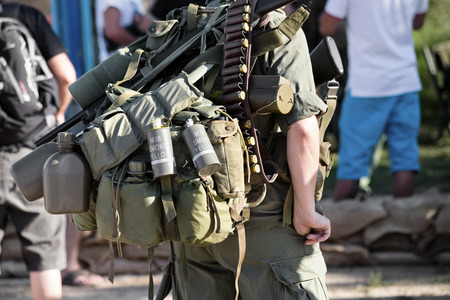 soldier carrying a backpack with combat equipment  ww2 reenactment photo