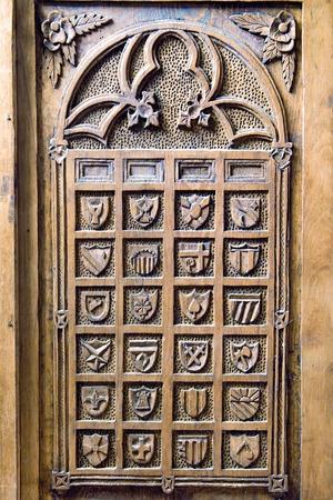 wood carving door: decorative figures carved wooden shields in the door of an antique closet Stock Photo