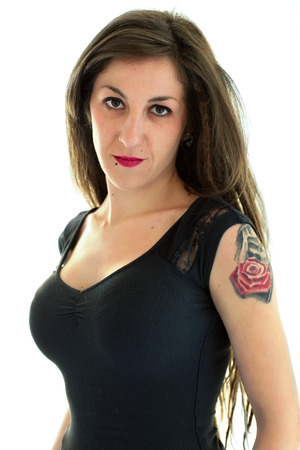 disobedient: bad girl with tattoo looking defiantly at the camera, isolated in white background  portrait of sexy girl looking at the camera Stock Photo