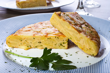 Spanish omelette with potatoes and onion, typical Spanish cuisine / Tortilla espanola Standard-Bild