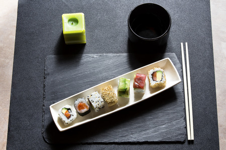 sushi menu: top view of dish with sushi menu on the table restaurant  Assorted sushi menu on the white plate