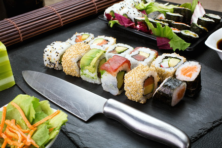 sushi restaurant: closeup of tray with sushi assorted on the table restaurant  japanese sushi Stock Photo