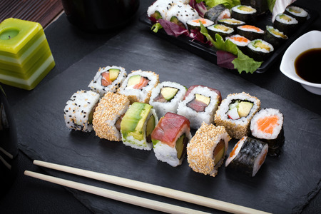 sushi plate: closeup of platter with sushi menu assorted on the table restaurant  sushi rolls on plate Stock Photo