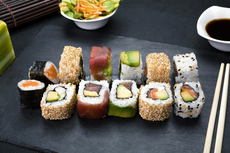 sushi plate: closeup of platter with sushi menu assorted on the table restaurant  sushi rolls Stock Photo