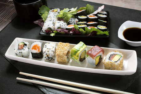 sushi restaurant: top view of dish with sushi menu assorted on the table restaurant  sushi platter Stock Photo