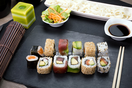 roll bar: closeup of platter with sushi menu assorted on the table restaurant  sushi rolls on the table Stock Photo