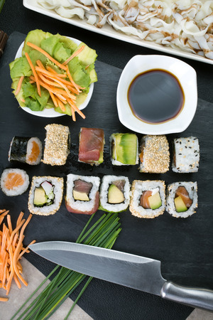 assortment: top view of table with sushi assorted in kitchen of restaurant  preparing japanese sushi