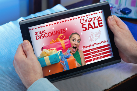 man searching website internet store to purchase Christmas presents online in christmas with your tablet in you home  hands of a man at a website with an announcement concept purchase Christmas presents online Stock Photo