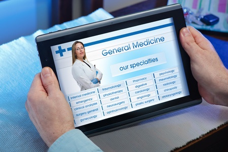 recruitment: man searching web internet for recruitment health insurance on internet with tablet in you home  hands of a man looking website of health service in the tablet