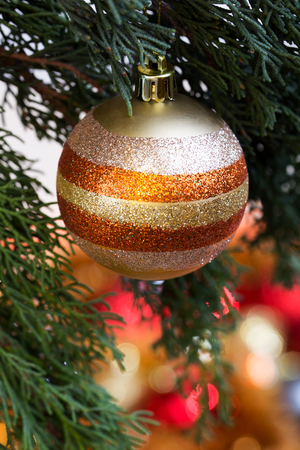 christmas tree presents: christmas ball in gold and blur background for xmas party in format vertical  ball on Christmas Tree for Christmas and New Year Decoration in format vertical Stock Photo