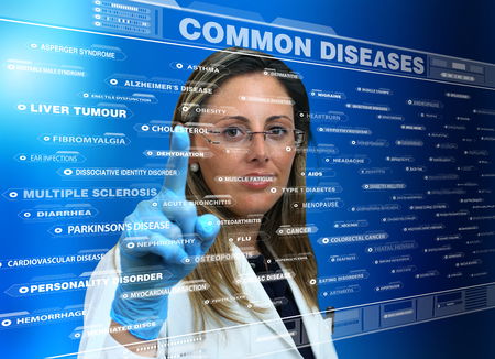 in common: female doctor touching the interface of a virtual application where a list of species common diseases  woman doctor using a virtual touch screen interface with a list Common diseases Stock Photo