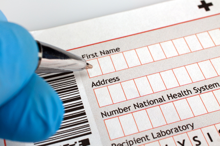 patient data: Doctor writing a prescription form of treatment for a patient  physician filling out a medical form of diagnosis with patient data