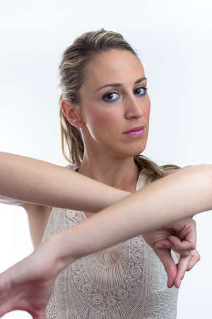 raise your hand: young woman dancing with a typical flamenco gesture  portrait of young woman dancing with arms raised Stock Photo