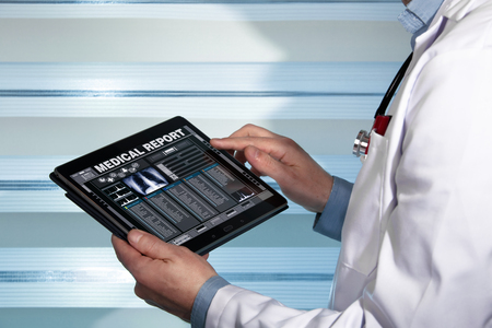 practitioner with a medical record health on the screen a digital device / doctor with tablet data consulting a medical report of a patient