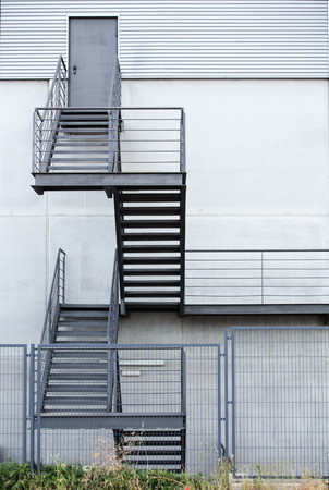 emergency stair: factory structure with emergency metal stair  emergency staircase of a factory Stock Photo