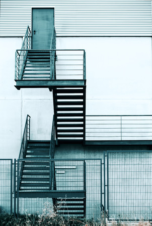 Industrial Structure With Emergency Metal Stair / Fire Escape Staircase In  A Modern Building Stock Photo