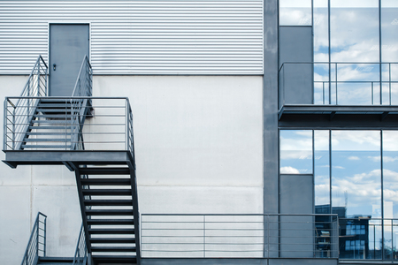 building on fire: business building with metal emergency staircase  Fire escape staircase in a modern office building