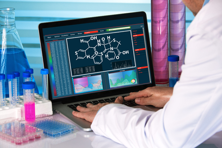chemical engineer working with analysis software on laptop in the research laboratory / research scientist using computer chemistry lab