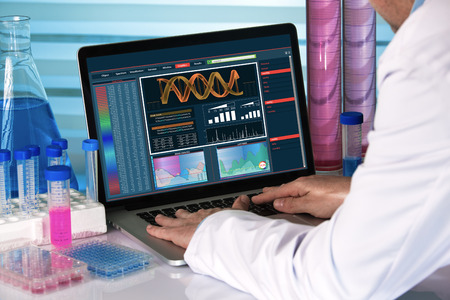 biotechnology: genetic engineer working with analysis dna software on laptop in the genetic laboratory  research geneticist using computer biotechnology lab Stock Photo