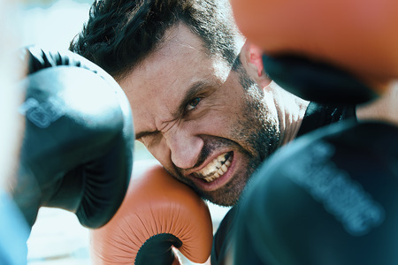 attacking fighter in a boxing training seen from the position of the opponent  close up shot of boxer in a fight from the point of view of rival