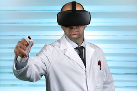 doctor in virtual medical tour with VR virtual reality glasses  Researcher wearing virtual reality glasses conducting a work remote Stock Photo