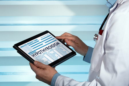 hypothyroidism: bariatrist with medical record digital on the tablet with text hypothyroidism in diagnostic  endocrine holding tablet with a hypothyroidism diagnosis in digital medical report