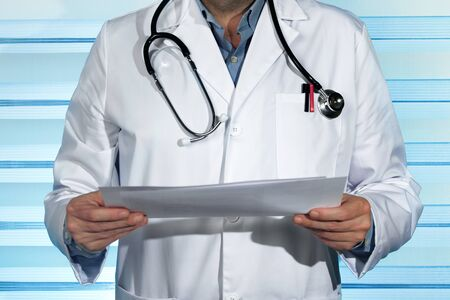 medical practitioner: Practitioner with stethoscope and holding medical records in hands  Doctor consulting patient medical reports