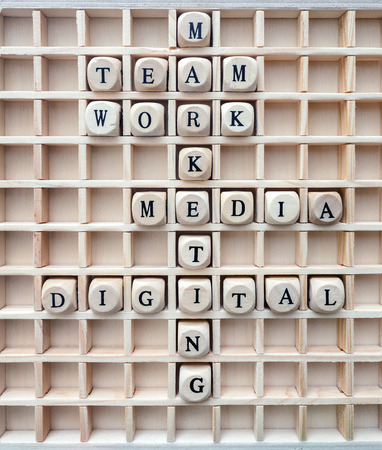 business letters: Words of business marketing concepts made with letters from a set of wooden cubes  concepts of communication digital marketing formed with wood cubes in the board Stock Photo