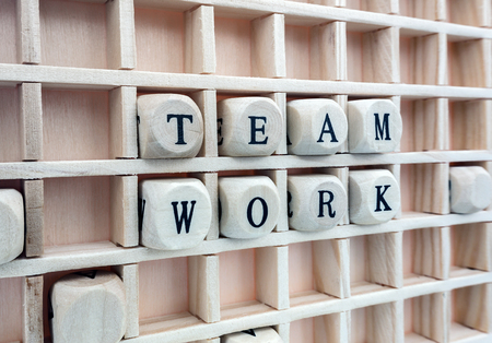 la union hace la fuerza: team work made with letters from a set of wooden cubes  Composition of the word team work formed with wood cubes in the board
