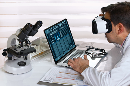 computer simulation: doctor with Virtual reality equipment in the laboratory  Doctor with virtual reality glasses working in consultation with a patient at a distance