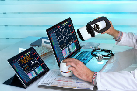 doctor with Virtual reality equipment in the laboratory / doctor with computers and virtual reality vr headset working in the lab