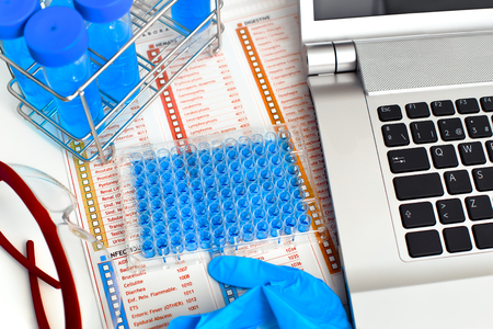 computer and tools of a pharmaceutical laboratory for drug research  working table of a pharmaceutical laboratory Imagens