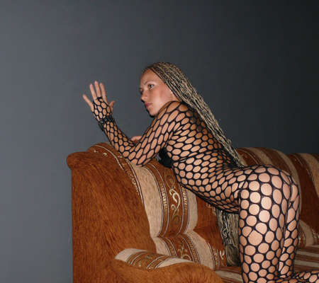 erotic girl: Nice erotic girl pose in a sofa Stock Photo