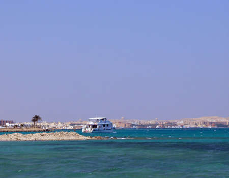 White ship get under way in the Red sea photo