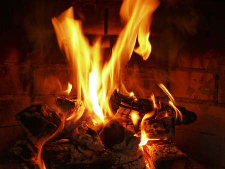 ignited: Burning wood in the fireplace Stock Photo