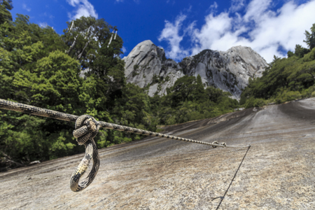 A rope is waiting to be used for climbing a cliff in Cochamo, Chile
