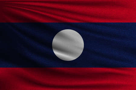 The national flag of Laos. The symbol of the state on wavy cotton fabric. Realistic vector illustration.