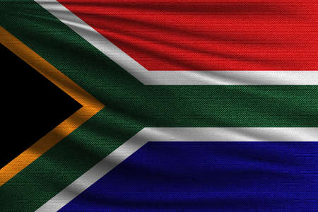 The national flag of South Africa. The symbol of the state on wavy cotton fabric. Realistic vector illustration. 矢量图像