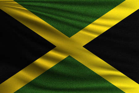 The national flag of Jamaica. The symbol of the state on wavy cotton fabric. Realistic vector illustration.