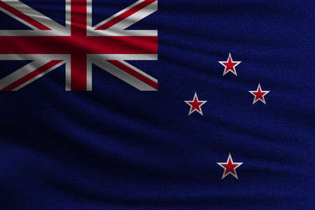 The national flag of New Zealand. The symbol of the state on wavy cotton fabric. Realistic vector illustration.