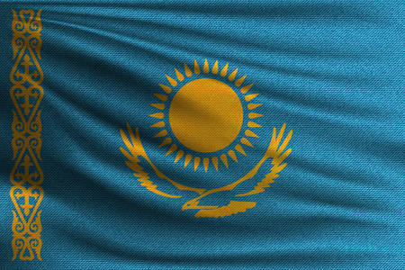 The national flag of Kazakhstan. The symbol of the state on wavy cotton fabric. Realistic vector illustration. 일러스트