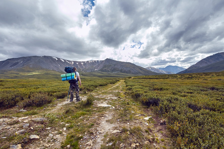 Journey on foot through the mountain valleys. The beauty of wildlife. Altai, the road to Shavlinsky lakes. Hike Stock Photo