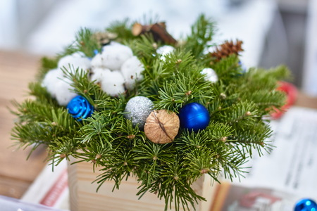 Manufacturer of Christmas decor with their own hands. Christmas box with twigs for the holiday. The new year celebration. Master class on making decorative ornaments