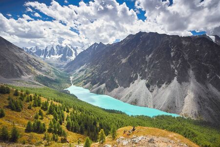 Journey on foot through the mountain valleys. Beauty of wildlife. Altai, the road to Shavlinsky lakes, Russia. Peaks of snowy mountains of Siberia. Hiking in the mountains in summer Stock Photo