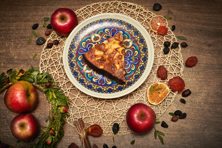 Delicious Apple pie baked at home. Sweet pie stuffed with apples. Apple cake on the table, culinary skills. Favorite dish of children Stock Photo