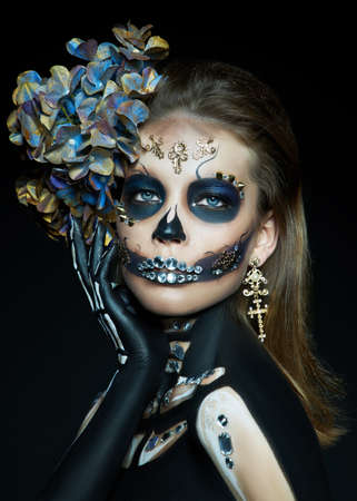 Halloween beauty portrait of a skeleton woman of death, the makeup on the face. Girl death Halloween costume. Day of The Dead. Charming and dangerous Calavera Catrina