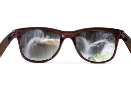 Sunglasses have a waterfall reflecting photo